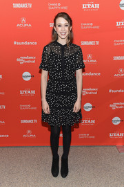 Taissa Farmiga kept her feet warm in black ankle boots.