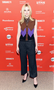Elle Fanning kept it casual yet adorably chic in a tricolor knit vest layered over a sleeveless button-down, both by Miu Miu, at the Sundance premiere of 'I Think We're Alone Now.'