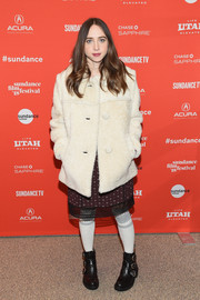 Zoe Kazan toughened up her look with a pair of black moto boots by The Frye Company.