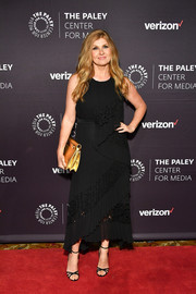 Connie Britton punctuated her black look with a metallic gold clutch.