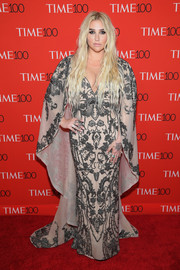 Kesha cut a regal figure in a caped, beaded nude gown by Mikael D at the 2018 Time 100 Gala.