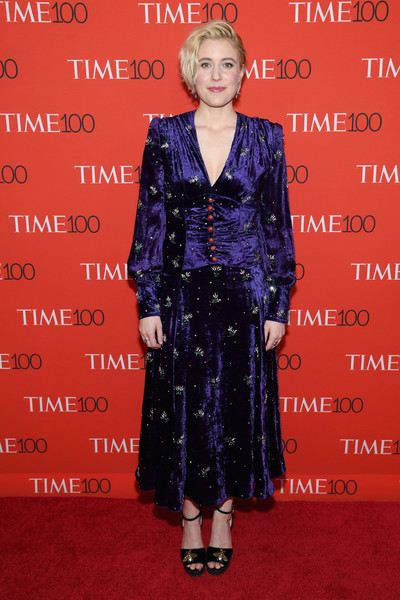 Greta Gerwig completed her red carpet look with a pair of bee-adorned platforms, also by Gucci.