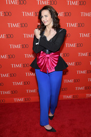Lynda Carter completed her colorful look with a pair of electric-blue silk pants, also by Gucci.