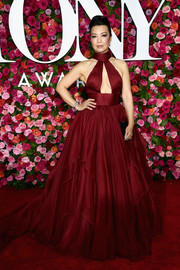 Ming-Na Wen looked sizzling-hot in a crimson Mark Zunino ball gown with a cleavage-baring cutout at the 2018 Tony Awards.
