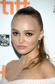 Lily-Rose Depp pulled her tresses back into a ponytail for the TIFF premiere of 'A Faithful Man.'