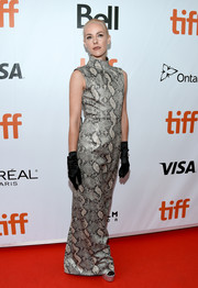 Jena Malone looked dramatic in an Emilia Wickstead snake-print gown teamed with black gloves at the TIFF premiere of 'The Public.'