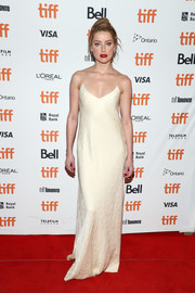 Amber Heard went minimalist-chic in a cream-colored slip gown by The Row at the TIFF premiere of 'Her Smell.'