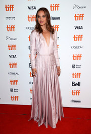 Natalie Portman looked downright elegant in a plunging pink gown by Dior Couture at the TIFF premiere of 'Vox Lux.'