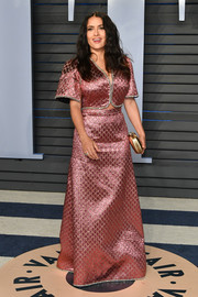 Salma Hayek was all about cool glamour in a metallic-pink crop-top by Gucci x Dapper Dan at the 2018 Vanity Fair Oscar party.