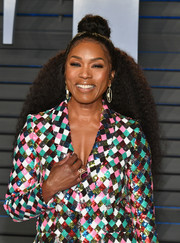 Angela Bassett styled her long, tight curls into a half-up bun for the 2018 Vanity Fair Oscar party.