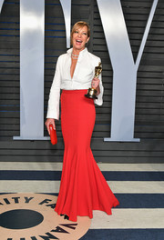 Allison Janney dressed up her shirt with a red mermaid skirt, also by Brandon Maxwell.