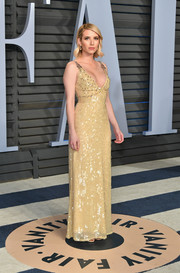 Emma Roberts glittered in a yellow sequin gown by Prada at the 2018 Vanity Fair Oscar party.