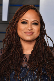 Ava DuVernay attended the 2018 Vanity Fair Oscar party wearing her trademark dreadlocks in a loose, messy-chic style.