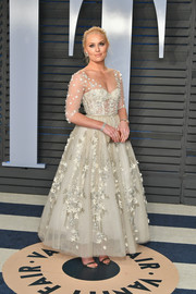 Lindsey Vonn looked exquisite in a star-embellished white corset gown at the 2018 Vanity Fair Oscar party.