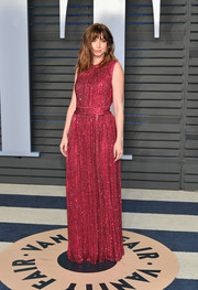 Ana de Armas looked delightful in a beaded raspberry gown by Dolce & Gabbana at the 2018 Vanity Fair Oscar party.