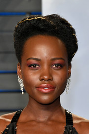 Lupita Nyong'o was dripping with Forevermark diamonds when she attended the 2018 Vanity Fair Oscar party.