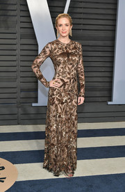 Emily Blunt looked opulent in a bird-and-foliage-motif sequin gown by Alexander McQueen at the 2018 Vanity Fair Oscar party.