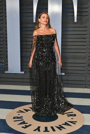 Sofia Vergara made a regal entrance in an ornately embellished black off-the-shoulder gown by Ralph & Russo Couture at the 2018 Vanity Fair Oscar party.