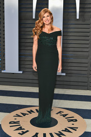 Connie Britton sheathed her slim figure in a dark green off-the-shoulder column dress by Pamella Roland for the 2018 Vanity Fair Oscar party.