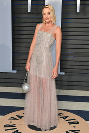 Margot Robbie looked heavenly in a beaded sheer-bottom gown by Chanel Couture at the 2018 Vanity Fair Oscar party.