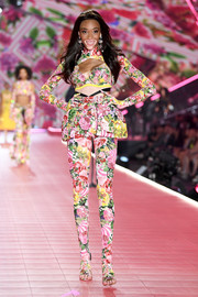 Winnie Harlow hit the Victoria's Secret runway wearing a cute floral bra.