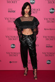 Liu Wen showed off her flat abs in a black ruffle crop-top by Philosophy di Lorenzo Serafini at the 2018 Victoria's Secret after-party.