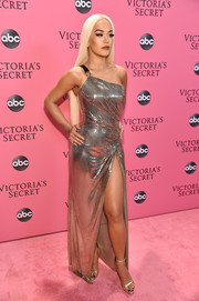 Rita Ora kept the shine going with a pair of gold ankle-strap sandals, also by Versace.