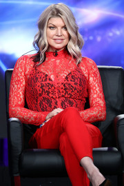 Fergie looked sassy in a red Givenchy lace top teamed with a black underlay at the 2018 Winter TCA Tour.