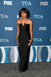 Angela Bassett was edgy, sexy, and chic in equal parts wearing this strapless, dual-textured jumpsuit at the Fox All-Star Party.