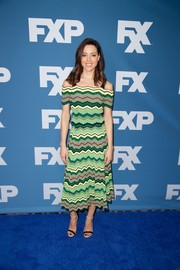 Aubrey Plaza cut a vibrant figure in a zigzag-patterned cold-shoulder knit top by Sandro at the 2018 Winter TCA Tour.