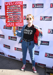 Zoey Deutch sealed off her ensemble with red canvas sneakers.