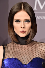 Coco Rocha matched her eyeshadow to her metallic blue dress.