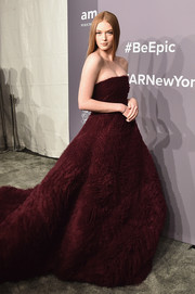 Larsen Thompson stole the spotlight in this strapless burgundy ball gown by Ong-Oaj Pairam at the 2018 amfAR Gala New York.