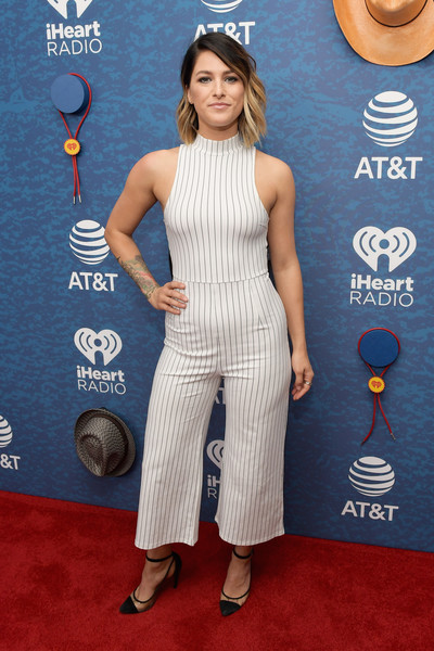 Cassadee Pope showed off her figure in a fitted pinstriped jumpsuit at the 2018 iHeartCountry Festival.