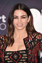Jenna Dewan-Tatum accessorized with a pair of geometric gold earrings by Jennifer Fisher.