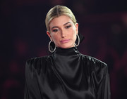 Hailey Baldwin paired her 'do with oversized diamond hoops by Norman Silverman.