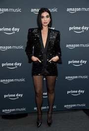 Dua Lipa continued the shine with a pair of patent platform pumps, also by Saint Laurent.