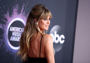 Heidi Klum went boho with this half-up hairstyle at the 2019 American Music Awards.