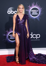 Carrie Underwood paired her dress with chunky gold platforms by Giuseppe Zanotti.