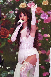 Camila Cabello looked alluring in her white lace gloves, dress, and stockings combo while performing at the 2019 American Music Awards.