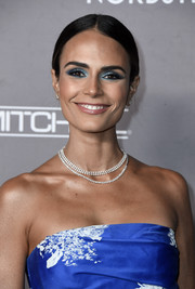 Jordana Brewster went for a festive beauty look with a sweep of shimmering blue eyeshadow.
