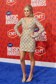 Carrie Underwood sealed off her look with a pair of strappy gold heels by Rene Caovilla.