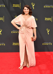 Rachel Bloom glammed up in a cape-sleeve blush gown for the 2019 Creative Arts Emmy Awards.
