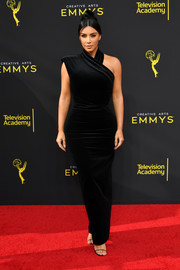 Kim Kardashian made an appearance at the 2019 Creative Arts Emmy Awards wearing an asymmetrical black velvet gown.