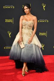 Nicole Scherzinger complemented her dress with a nude box clutch.