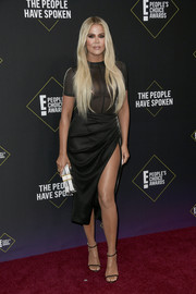 Khloe Kardashian sealed off her look with black slim-strap sandals by Jimmy Choo.