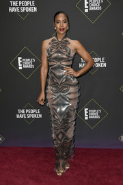 Kelly Rowland was modern and sexy in a sheer metallic gown by Iris van Herpen Couture at the 2019 E! People's Choice Awards.