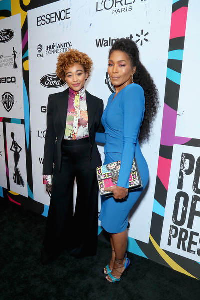 Angela Bassett punctuated her blue outfit with a mixed-print clutch by Etro.
