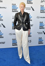 Tilda Swinton was edgy and cool in a black laser-cut leather jacket by Haider Ackermann at the 2019 Film Independent Spirit Awards.