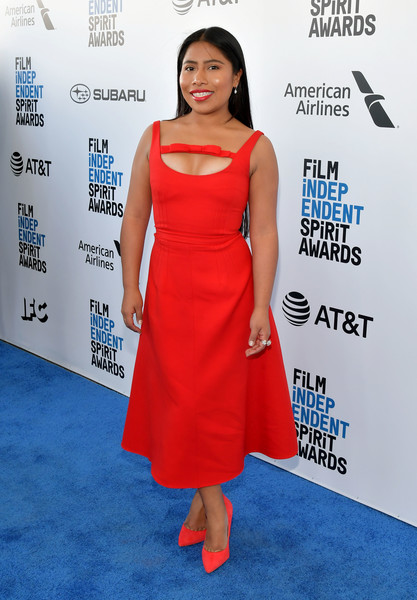 Yalitza Aparicio charmed in a red fit-and-flare cutout dress by Miu Miu at the 2019 Film Independent Spirit Awards.